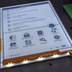 Il prototipo PocketBook. Si notano le piccole luci che illuminano lo schermo e-ink